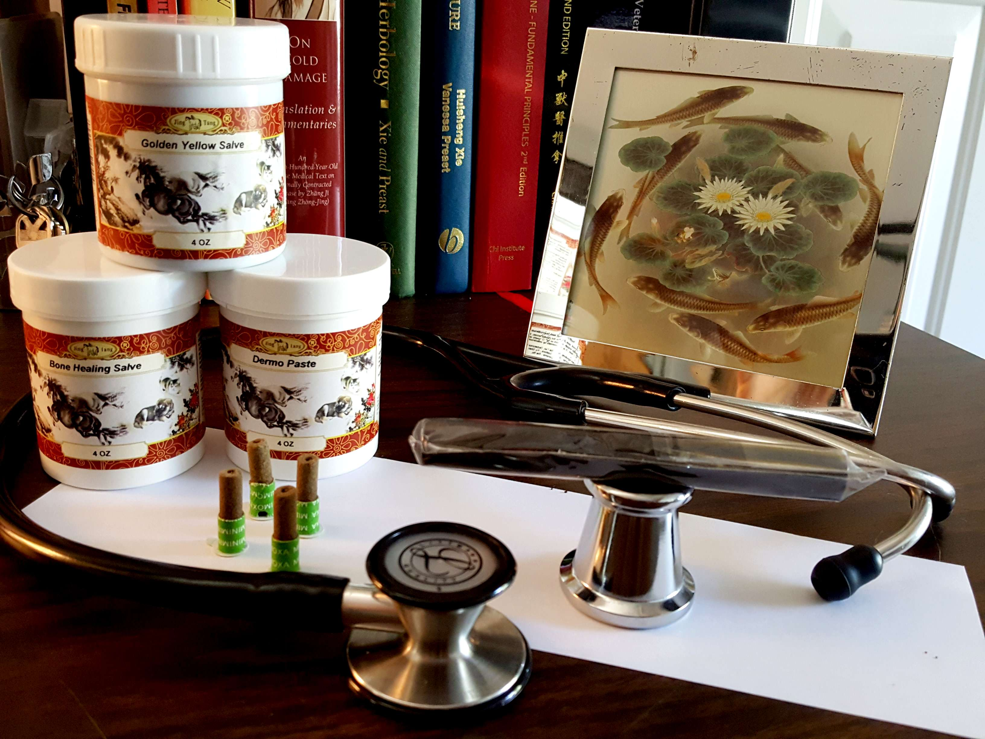 Chinese dog herbal therapy - Tubs Of Herbal Salves And Sticks Of Artemesia Root Moxa Await A Patient